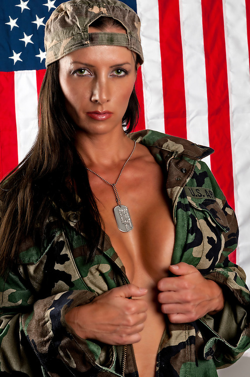 Portrait of woman on her thirties, wearing military jacket, very sensual pose.
