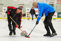 "Chris Miller and Phil Swanson on sweep for the ""Four Sheets to the Wind"" team during Curling League play Thursday evening at the Plymouth State University Ice Arena.  (Karen Bobotas/for the Laconia Daily Sun)"