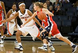 Richmond guard Kara Powell (14) dribbles around Virginia guard Sharnee Zoll (5).  The Virginia Cavaliers women's basketball team faced the Richmond Spiders at the John Paul Jones Arena in Charlottesville, VA on November 18, 2007.