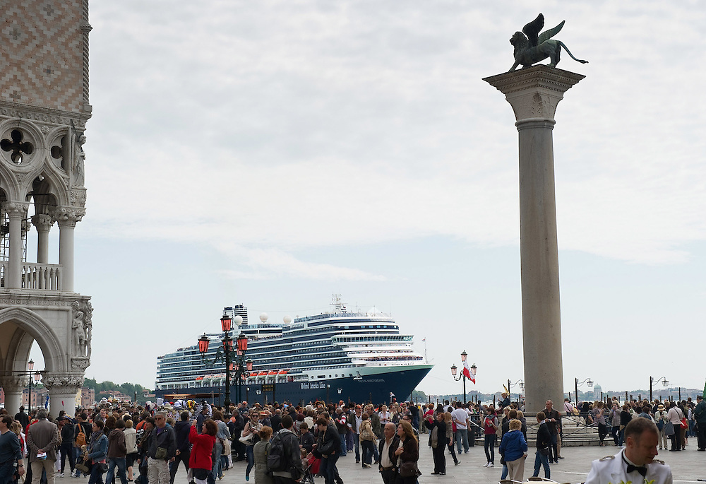 VENICE, ITALY - MAY 02:  Cruise ship Nieuw Amesterdam sails in front of St Mark Square and Palazzo Ducale on May 2, 2011 in Venice, Italy. Giant cruise ships passing through  St Mark Basin and Giudecca Canal are causing continue controversy for the possible damages to the lagoon and Venice buildings  (Photo by Marco Secchi/Getty Images)