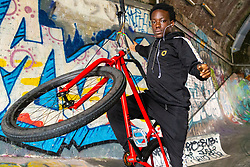 Trizzy, 16, does a no-hand free-wheeling wheelie. Bikestormz is the brainchild of leader Mac Ferrari, a group of young trick cyclists who are encouraged to put knives down and enjoy the healthy, positive side of urban youth culture by joining together  and developing their cycling skills. . London, September 27 2019.