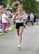 Middletown, New York - Amber Goodspeed of Middletown finishes the 15th annual Ruthie Dino Marshall 5K Run and Fun Walk hosted by the Middletown YMCA on Sunday, June 5, 2011. Goodspeed won the women's 15-19 age group. ©Tom Bushey / The Image Works