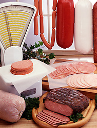Food scale brisket of beef salami bologna sausage hot dogs sliced turkey wooden carving board wax paper Americana Entrepreneurship Grocery store window scene deli delicatessan grocery store Bon Appetit