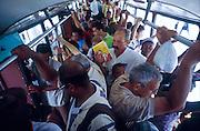 "25 JULY 2002 - HAVANA, HAVANA, CUBA: People ride a ""camello"" or camel bus, so called because of its distinctive hump backed shape in Havana, Cuba, July 25, 2002..PHOTO BY JACK KURTZ"