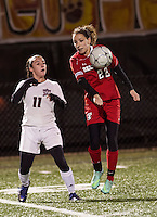 Fall Mountain's Maddie DiBernardo and Belmont's Emma Chase go for the ball during NHIAA Division III State Championship soccer at Jim Fitzgerald Field on Sunday evening.   (Karen Bobotas/for the Laconia Daily Sun)
