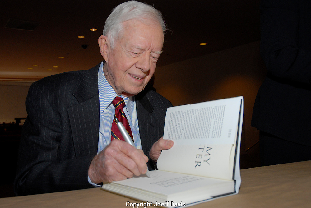 """ATLANTA, GA - DEC 8, 2006: Former president Jimmy Carter signs copies of his book """"Palestine: Peace Not Apartheid"""" at the Carter Center. Carter also spoke at the event defending his book and speaking of his commitment to finding peace in the Middle East, """"The greatest commitment in my life has been trying to bring peace to Israel,"""" Carter said, adding """"Israel will never have peace until they agree to withdraw"""" from the occupied territories."""""""