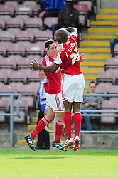 Bristol City's Marvin Elliott celebrates his goal with Bristol City's Greg Cunningham   - Photo mandatory by-line: Dougie Allward/JMP - Tel: Mobile: 07966 386802 11/08/2013 - SPORT - FOOTBALL - Sixfields Stadium - Sixfields Stadium -  Coventry V Bristol City - Sky Bet League One