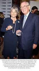 LORD & LADY SAINSBURY OF PRESTON CANDOVER, at a reception in London on 17th September 2002.PDH 180