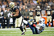 NEW ORLEANS, LA - NOVEMBER 8:  Mark Ingram #22 of the New Orleans Saints runs through the attempted tackle by Zach Brown #55 of the Tennessee Titans at Mercedes-Benz Superdome on November 8, 2015 in New Orleans, Louisiana.  (Photo by Wesley Hitt/Getty Images) *** Local Caption *** Mark Ingram; Zach Brown
