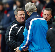 Picture by Mike  Griffiths/Focus Images Ltd +44 7766 223933<br /> 01/01/2014<br /> Arsene Wenger of Arsenal and David Kerslake of Cardiff City during the Barclays Premier League match at the Emirates Stadium, London.