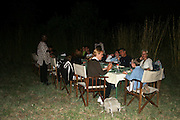 Africa, Tanzania, Serengeti National Park Outdoor dinner at the lodge tourists around the table