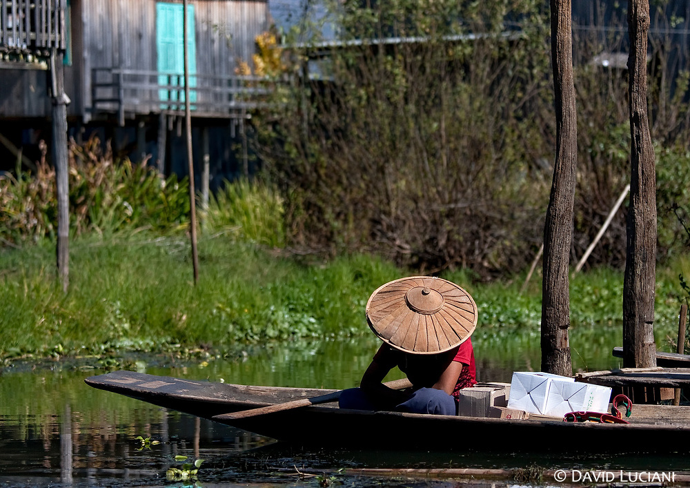 A woman dozing in a boat on Inle lake.
