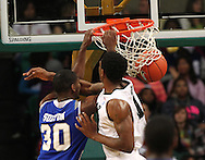 Dec 07, 2011; Birmingham, AL, USA;  Middle Tennessee Blue Raiders  forward JT Sulton (30) is fouled by UAB Blazers forward Ovie Soko (0) at Bartow Arena. The Blazers defeated the Blue Raiders 66-56 Mandatory Credit: Marvin Gentry-