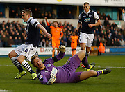 Colchester FC Goalkeeper Jamie Jones lay defeated on the floor after Millwall FC Midfielder Shane Ferguson scores during the Sky Bet League 1 match between Millwall and Colchester United at The Den, London, England on 21 November 2015. Photo by Andy Walter.