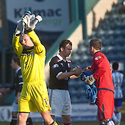 Dundee keeper Rab Douglas applauds the fans at the end of his 250th appearance for the Dark Blues, while in the background Kilmarnock keeper Cameron Bell consoles Dundee's Matt Lockwood - Bell saved Lockwood's penalty kick during Dundee v Kilmarnock, William Hill Scottish FA Cup 4th Round,..- © David Young - .5 Foundry Place - .Monifieth - .DD5 4BB - .Telephone 07765 252616 - .email; davidyoungphoto@gmail.com - .web; www.davidyoungphoto.co.uk.