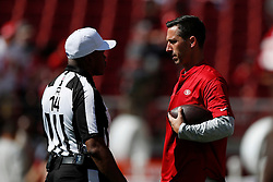 SANTA CLARA, CA - OCTOBER 07: Head coach Kyle Shanahan of the San Francisco 49ers speaks with referee Shawn Smith #14 prior to their game against the Arizona Cardinals at Levi's Stadium on October 7, 2018 in Santa Clara, California. (Photo by Jason O. Watson/Getty Images)
