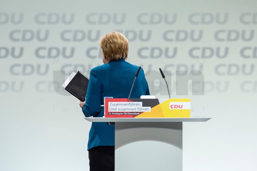 07 DEC 2018, HAMBURG/GERMANY:<br /> Angela Merkel, CDU, Bundeskanzlerin, verlaesst das Rednerpult, nach Ihrer letzten Rede als Parteivorsitzende, CDU Bundesparteitag, Messe Hamburg<br /> IMAGE: 20181207-01-031<br /> KEYWORDS: party congress, specch