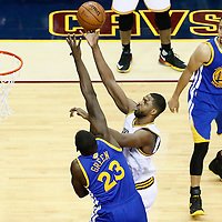 10 June 2016: Cleveland Cavaliers center Tristan Thompson (13) goes for the layup over Golden State Warriors forward Draymond Green (23) during the Golden State Warriors 108-97 victory over the Cleveland Cavaliers, during Game Four of the 2016 NBA Finals at the Quicken Loans Arena, Cleveland, Ohio, USA.