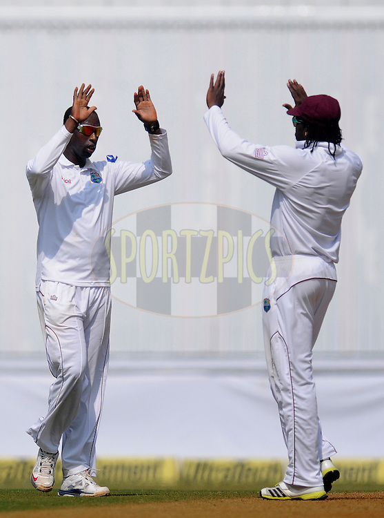 Shane Shillingford of West Indies celebrates the wicket of Virat Kholi of India during day two of the second Star Sports test match between India and The West Indies held at The Wankhede Stadium in Mumbai, India on the 15th November 2013<br /> <br /> This test match is the 200th test match for Sachin Tendulkar and his last for India.  After a career spanning more than 24yrs Sachin is retiring from cricket and this test match is his last appearance on the field of play.<br /> <br /> <br /> Photo by: Pal PIllai - BCCI - SPORTZPICS<br /> <br /> Use of this image is subject to the terms and conditions as outlined by the BCCI. These terms can be found by following this link:<br /> <br /> http://sportzpics.photoshelter.com/gallery/BCCI-Image-Terms/G0000ahUVIIEBQ84/C0000whs75.ajndY