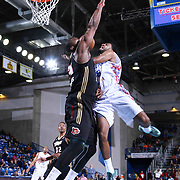 Delaware 87ers Guard DJ Seeley (18) drives towards the basket as Erie BayHawks Forward Kadeem Batts (31) defends in the first half of a NBA D-league regular season basketball game between the Delaware 87ers and the Erie BayHawk (Orlando Magic) Friday, Mar. 27, 2015 at The Bob Carpenter Sports Convocation Center in Newark, DEL.