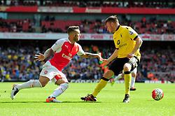 Jack Wilshere of Arsenal attempts to turn inside Kevin Toner - Mandatory by-line: Dougie Allward/JMP - 15/05/2016 - FOOTBALL - Emirates Stadium - London, England - Arsenal v Aston Villa - Barclays Premier League