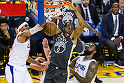 Golden State Warriors forward Andre Iguodala (9) dunks the ball against the LA Clippers at Oracle Arena in Oakland, California, on February 22, 2018. (Stan Olszewski/Special to S.F. Examiner)