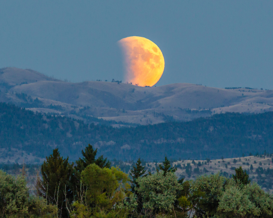 The super blood moon is partially eclipsed as it rises over the mountains east of Helena on the evening of September 27th, 2015.