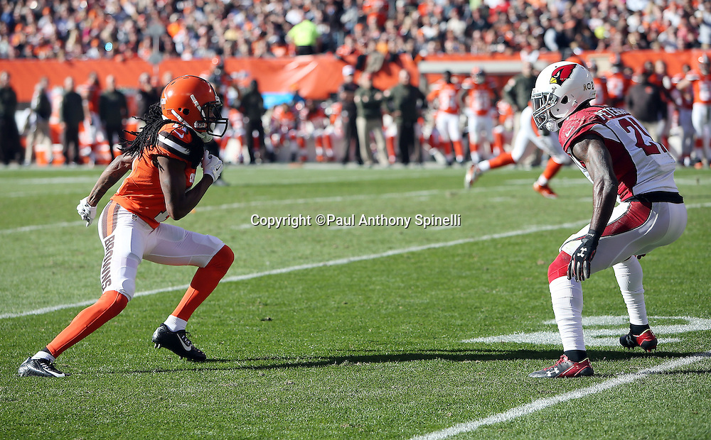 Cleveland Browns wide receiver Travis Benjamin (11) runs a second quarter pass route while covered by Arizona Cardinals cornerback Patrick Peterson (21) during the 2015 week 8 regular season NFL football game against the Arizona Cardinals on Sunday, Nov. 1, 2015 in Cleveland. The Cardinals won the game 34-20. (©Paul Anthony Spinelli)