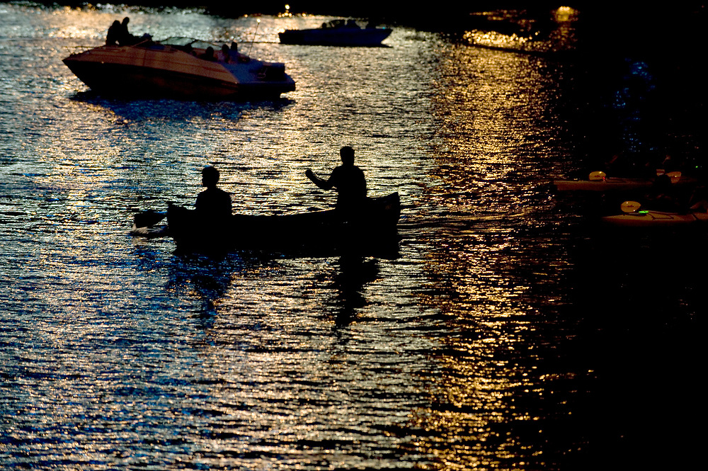 Boaters float on the Allegheny River before the fireworks begin on the Fourth of July in Pittsburgh.