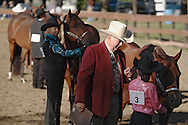 Middletown, NY - A judge talks to a young girl competing with her horse at the Middletown Rotary Horse Show at Fancher Davidge Park on Sept. 16, 2007.