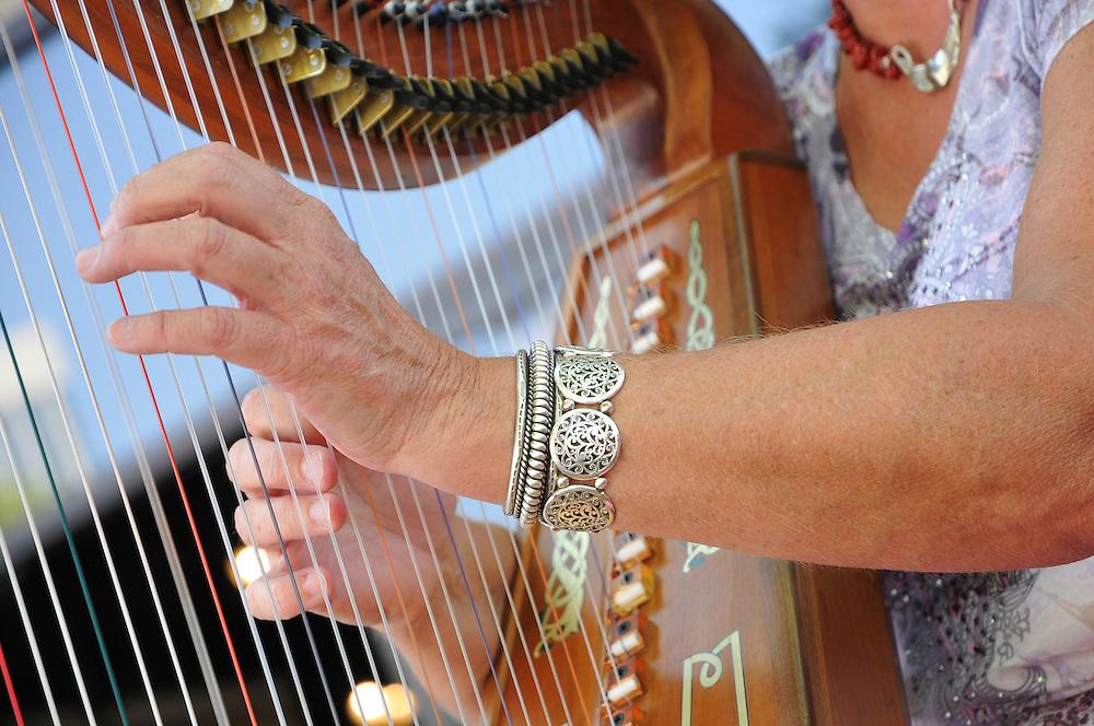 Hand closeup of Adirondack Harpist Martha Gallagher in concert at the 2012 Tucson Folk Festival.