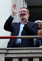 "© Licensed to London News Pictures. 13/07/2013<br /> <br /> Durham City, England, United Kingdom<br /> <br /> General Secretary of the Unite union, Len McCluskey applauds during the Durham Miners Gala as colliery bands make their way past the County Hotel.<br /> <br /> The Durham Miners' Gala is a large annual gathering held each year in the city of Durham. It is associated with the coal mining heritage of the Durham Coalfield, which stretched throughout the traditional County of Durham, and also gives voice to miners' trade unionism. <br /> <br /> Locally called ""The Big Meeting"" or ""Durham Big Meeting"" it consists of banners, each typically accompanied by a brass band, which are marched to the old Racecourse, where political speeches are delivered. In the afternoon a Miners' service is held in Durham Cathedral <br /> <br /> Photo credit : Ian Forsyth/LNP"
