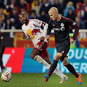 Michael Bradley, Toronto FC, on the ball challenged by Thierry Henry, New York Red Bulls, during the New York Red Bulls Vs Toronto FC, Major League Soccer regular season match at Red Bull Arena, Harrison, New Jersey. USA. 11th October 2014. Photo Tim Clayton