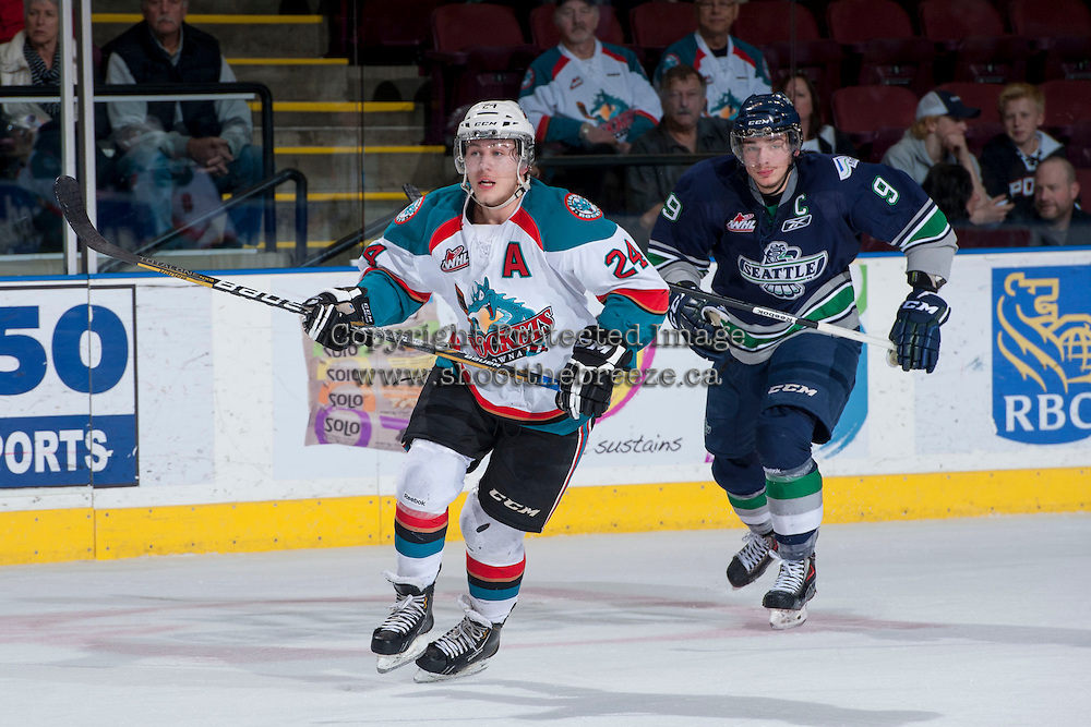 KELOWNA, CANADA - APRIL 3: Tyson Baillie #24 of the Kelowna Rockets and Justin Hickman #9 of the Seattle Thunderbirds skate on April 3, 2014 during Game 1 of the second round of WHL Playoffs at Prospera Place in Kelowna, British Columbia, Canada.   (Photo by Marissa Baecker/Getty Images)  *** Local Caption *** Tyson Baillie; Justin Hickman;