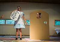 Alice (Zoe Lehneman) takes a drink to get smaller with Doorknob (Savannah Shepard) during dress rehearsal for Alice in Wonderland with SKYT Monday evening.  (Karen Bobotas/for the Laconia Daily Sun)