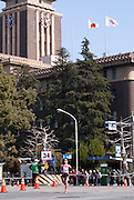 The Japanese and Nagoya City flags on the Nagoya City government offices flew at half-mast as the Nagoya Women's Marathon ran past.