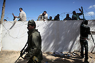 Tunisia's Ras Jdir main border crossing with Libya is overwhelmed by thousands of people fleeing unrest and faces a humanitarian crisis. From Tunisia's side, Egyptians are repelled by Tunisians from jumping  the wall separating with Lybia. 1st March 2011.