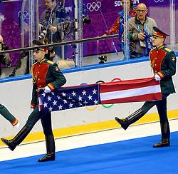 20-02-2014 IJSHOCKEY: OLYMPIC GAMES: SOTSJI<br /> De finale tussen USA en Canada wordt door Canada in de extra tijd door een golden goal met 3-2 gewonnen / De Amerikaanse vlag wordt binnengedragen voor de ceremonie en Klaas Jan van der Weij bekijkt het tafereel aan.<br /> ©2014-FotoHoogendoorn.nl