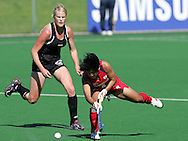 Keiko MANABE and Anna THORPE during the BDO Women's Champions Challenge 1 match between New Zealand and Japan held at the Hartleyvale Stadium in Cape Town, South Africa on the 17 October 2009 ..Photo by RG/www.sportzpics.net.+27 21 (0) 21 785 6814