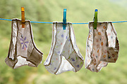underwear of a young child hanging on a wash line