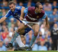 Photo: Daniel Hambury.<br />Chelsea v Aston Villa. The Barclays Premiership. 30/09/2006.<br />Chelsea's Andriy Shevchenko grabs the shorts of Villa's Gavin McCann.