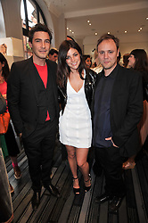 Left to right, ROBERT KONJIC, JULIA RESTOIN ROITFELD and NICHOLAS KIRKWOOD at the opening party for Nicholas Kirkwood's new store at 5 Mount Street, London on 12th May 2011.