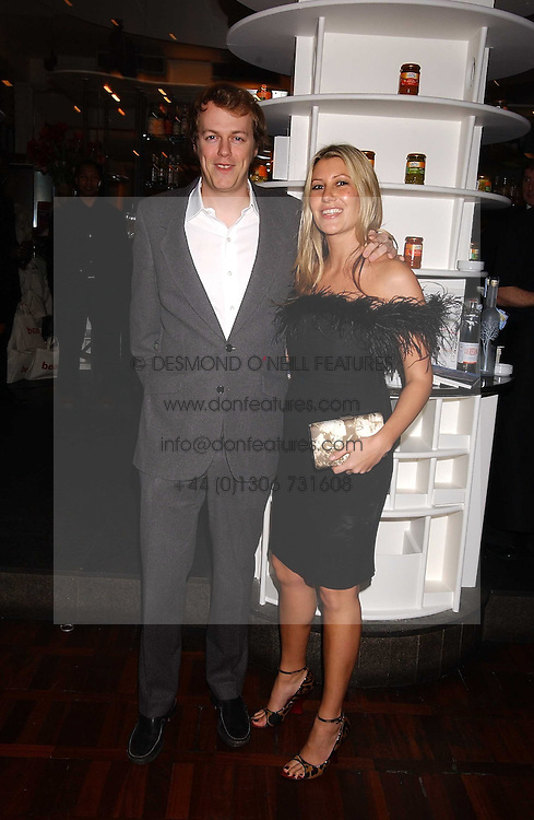 TOM PARKER BOWLES son of Camilla Parker Bowles and MISS SARA BUYS at a party to celebrate the publication of 'E is for Eating' by Tom Parker Bowles held at Kensington Place, 201 Kensington Church Street, London W8 on 3rd November 2004.<br /><br />NON EXCLUSIVE - WORLD RIGHTS