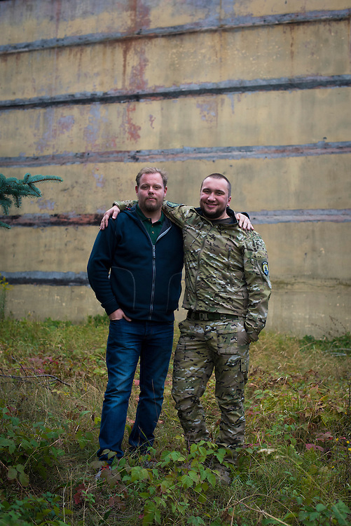 Bogdan Zvarych, manager of Azov Engineering Group's garage, poses for a portrait with Mikael Skillt, a Swedish advisor and fighter with Azov Battalion, on September 9, 2015 in Kyiv, Ukraine.