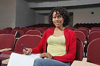 Portrait of female college student lone in classroom