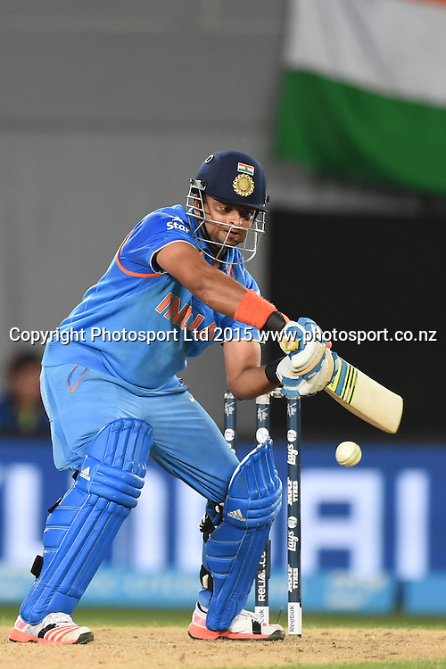 Indian batsman Suresh Raina in action during the ICC Cricket World Cup match between India and Zimbabwe at Eden Park in Auckland, New Zealand. Saturday 14 March 2015. Copyright Photo: Raghavan Venugopal / www.photosport.co.nz