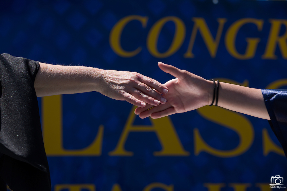 Milpitas High School Principal Principal Cheryl Lawton, left, shakes hands with her students during the graduation ceremony at Milpitas High School in Milpitas, California, on June 6, 2015. (Stan Olszewski/SOSKIphoto)