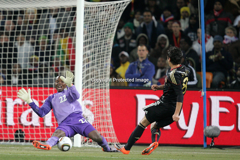 Richard Kingson of Ghana saves the shot of Mesut Oezil of Germany  during the the FIFA World Cup 2010 match between Ghana and Germany held at The Soccer City Stadium in SOWETO, Johannesburg, South Africa on the 23rd June 2010<br /> <br /> <br /> Photo by Ron Gaunt/SPORTZPICS