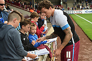 Darius Henderson signs autographs before the Sky Bet League 1 match between Scunthorpe United and Blackpool at Glanford Park, Scunthorpe, England on 5 September 2015. Photo by Ian Lyall.