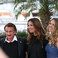 Sean Penn, Roberta Armani and Petra Nemcova at the HAÏTI CARNAVAL IN CANNES photocall at the 65th Cannes Film Festival. Friday 18th May 2012 in Cannes Film Festival, France.